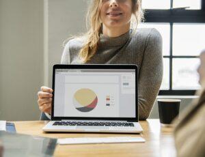 woman showing data at token pr agency