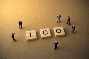 ICO blocks with businessmen around it